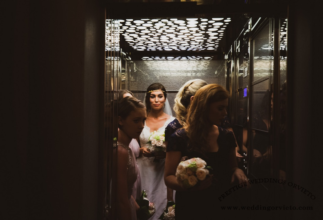 Bride and bridesmaids in the lift