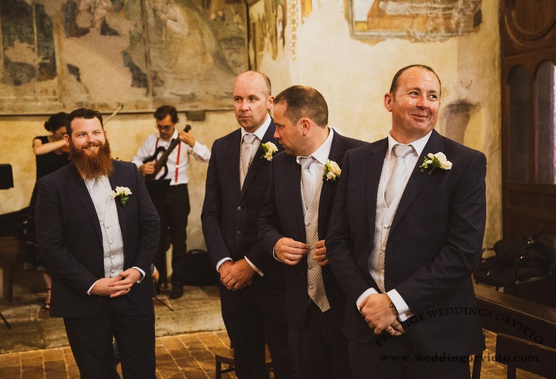 4 groosmen in the church waiting the bride arrival in Orvieto's Churc