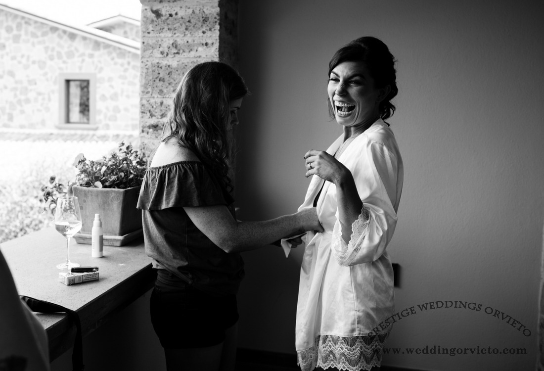 Bride smailing during getting ready with her bridesmaid