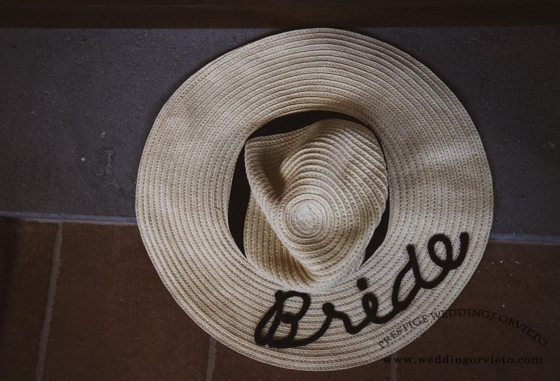 White floppy hat with Bride written on top on a floor