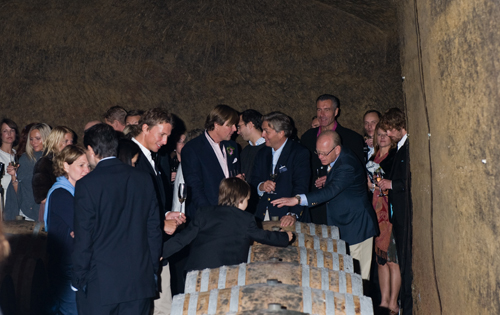 Wine tasting in Orvieto Decugnano dei Barbi. people from NOrway during the wedding are having a wine tasting and a visit of the cantine. Guests dressed in blue semiformal style