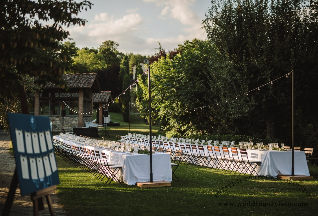 Long tables with white table clothe on a garden