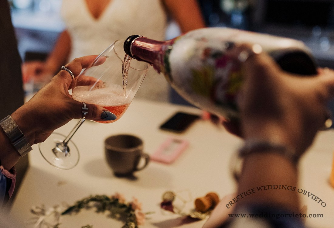 Rosé Wine served at the bride telephone coffee cup and tiara on a white table get ready wedding in Orvieto