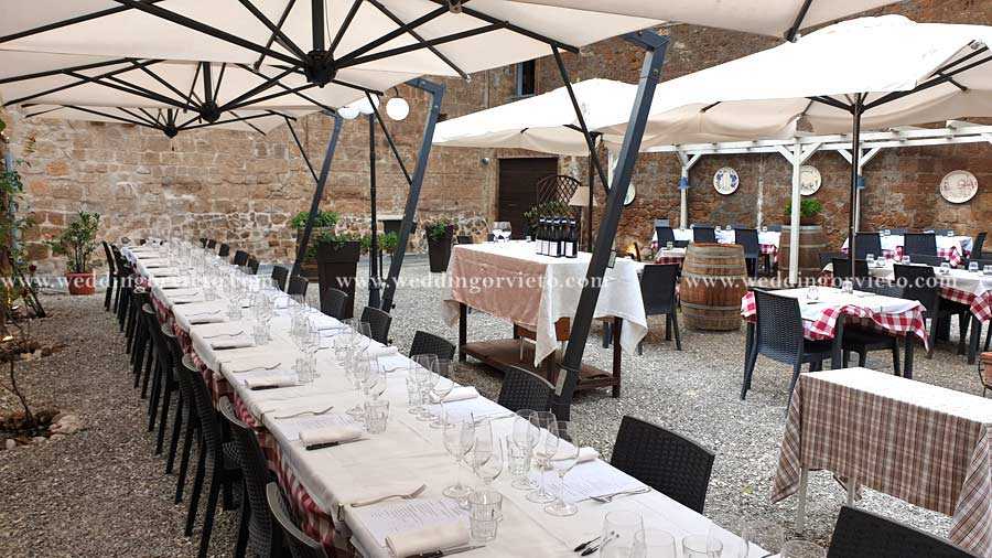 long table with white tablecloth in Orvieto